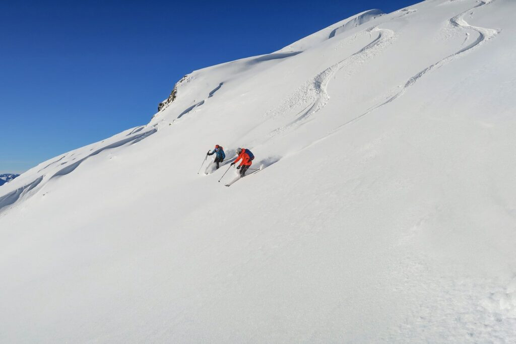 guide and student skiing
